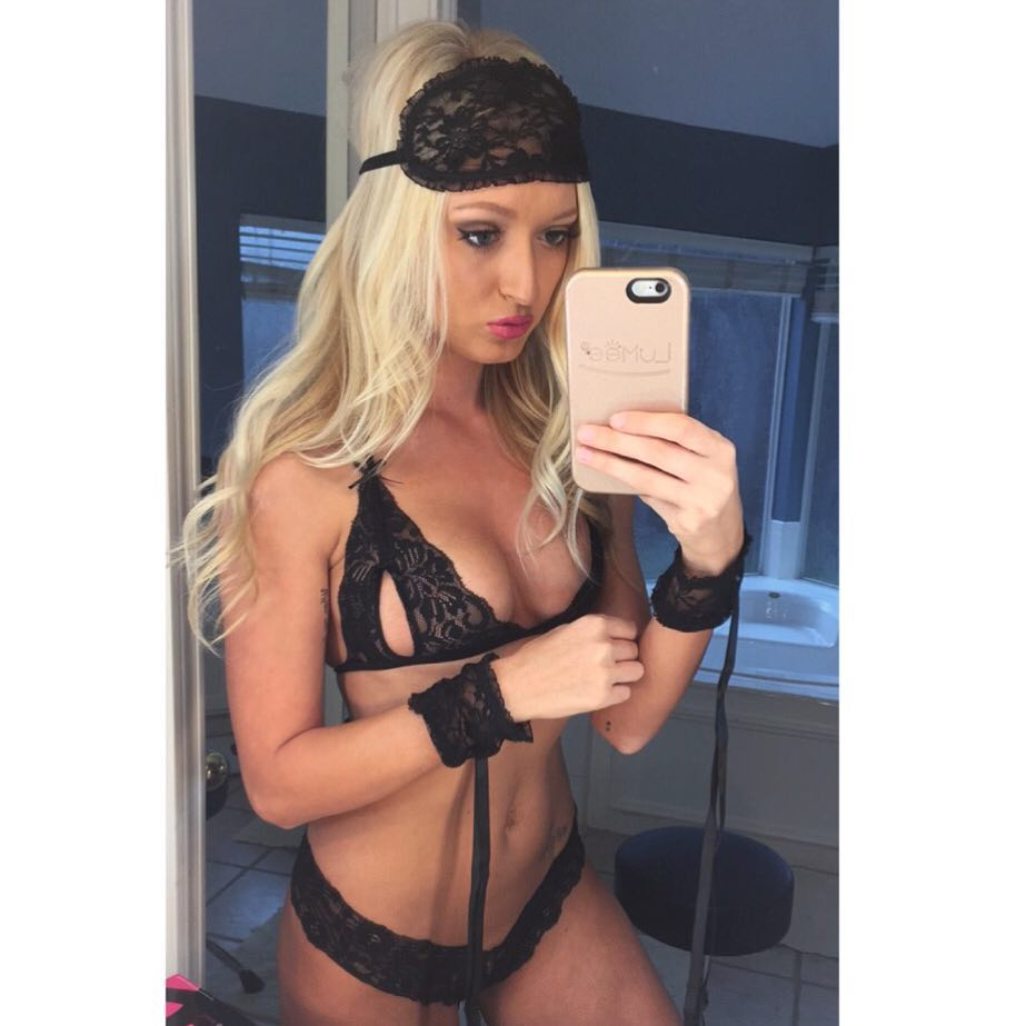 sexy blonde fitness model Samantha Nicole taking a selfie in black lace lingerie