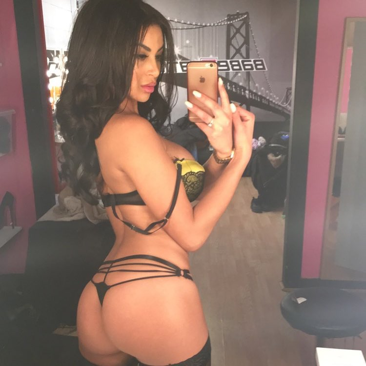 sexy brunette Olivia Berzinc taking a sexy selfie of her perfect ass in a thong