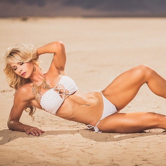 sexy blonde fitness model Heather Marsh in a bikini on the beach