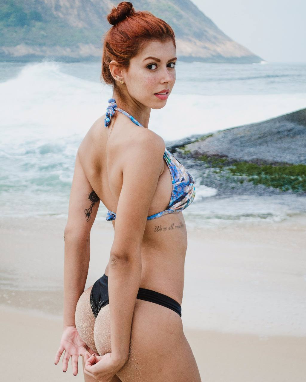 busty redhead model Aline Brito in a thong