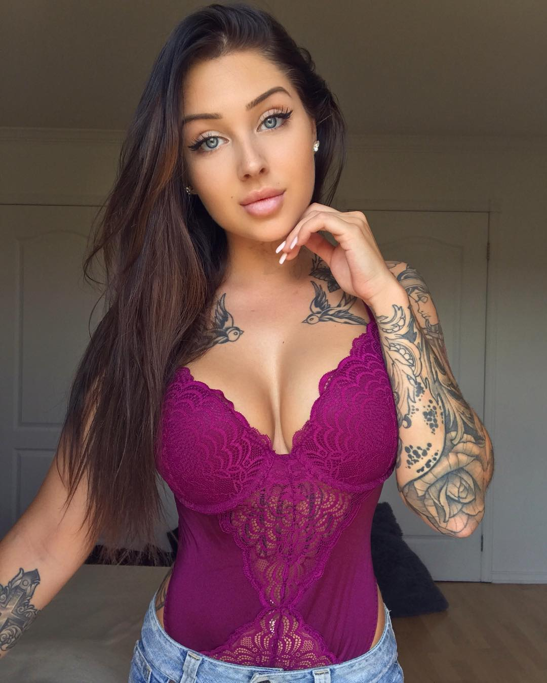 sexy inked brunette Valerie Cossette taking a selfie in purple lingerie