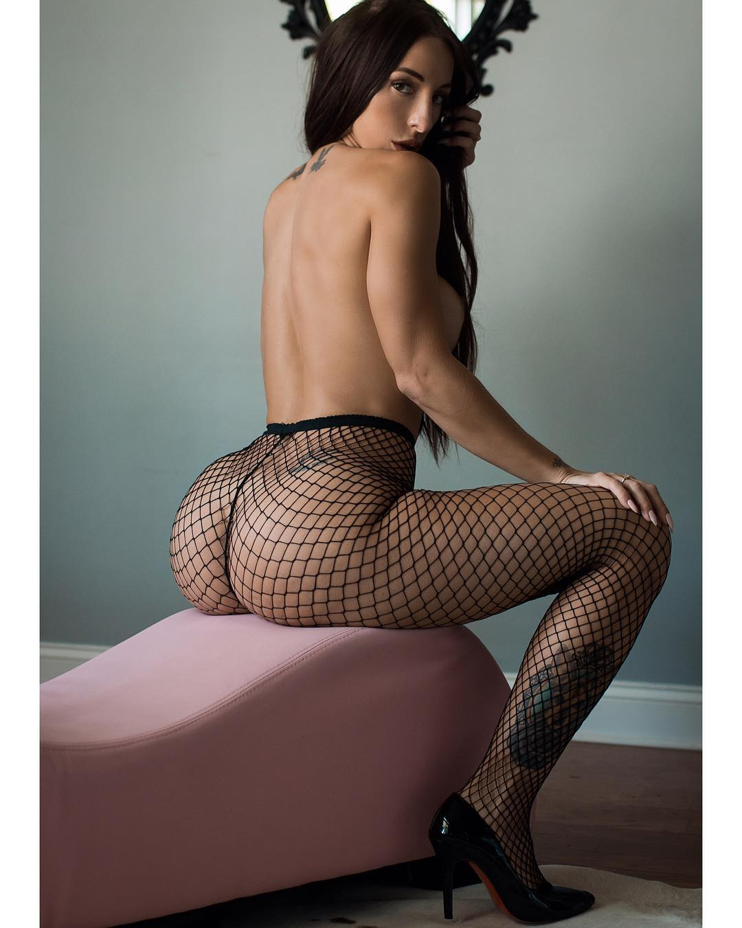 sexy brunette model Samantha Shane showing off her sexy booty in fishnet stockings