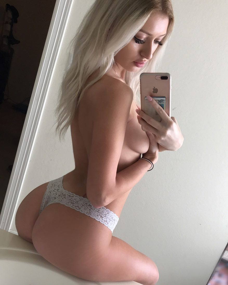 blonde fitness model Samantha Nicole taking a sexy selfie in white lace thong panties