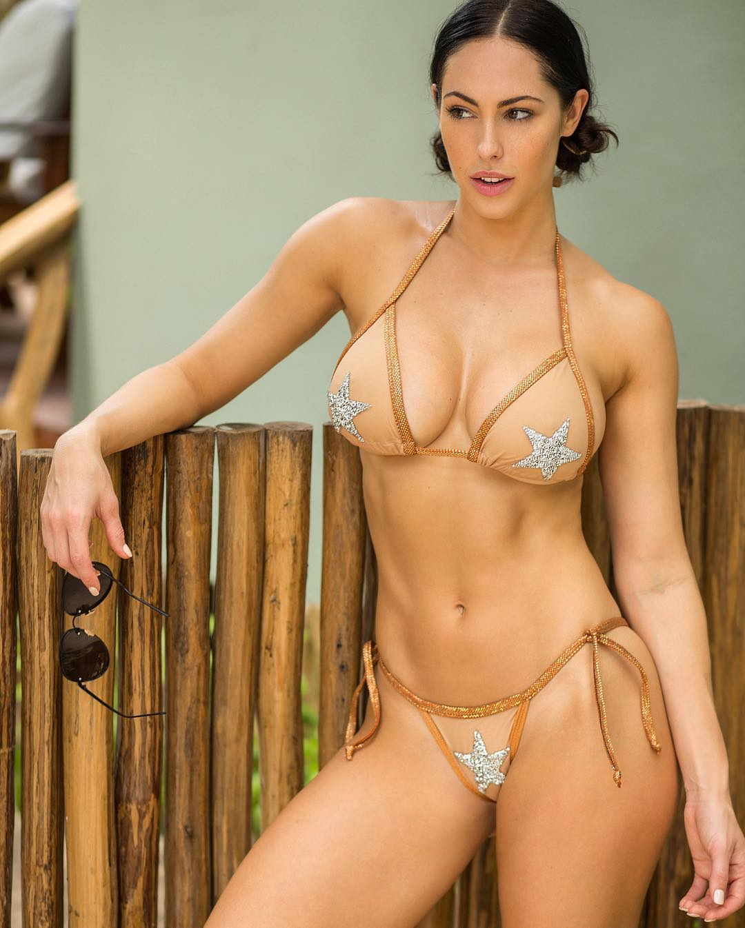 busty brunette fitness model Hope Beel - perfect boobs in a sexy gold bikini
