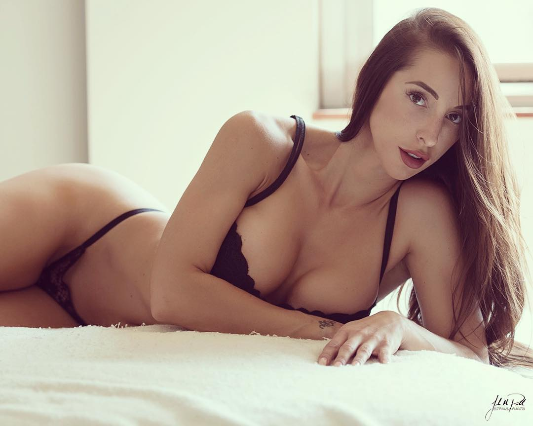 sexy brunette model Samantha Shane lying on the bed in lingerie