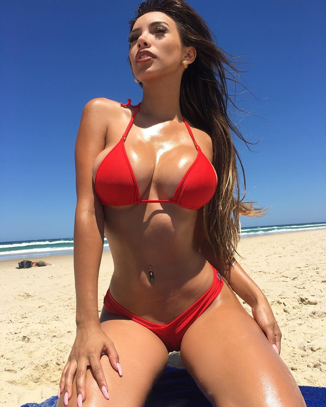 busty Paula Manzanal in a red bikini. Big tits. Cleavage