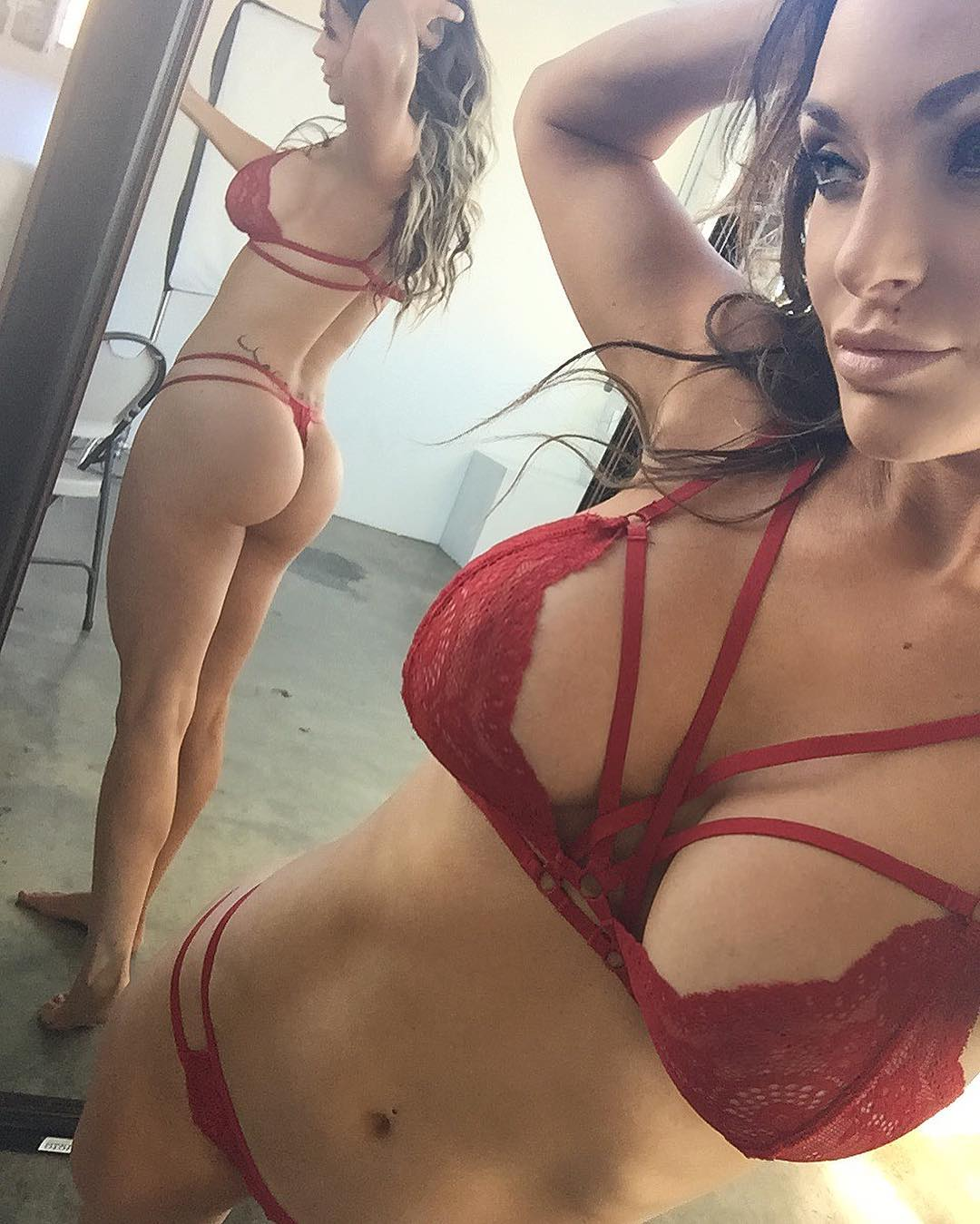 busty Nienna Jade in red lingerie.  thong.  perfect ass