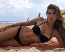 Sexy and busty model Kara Del Toro in a black bikini