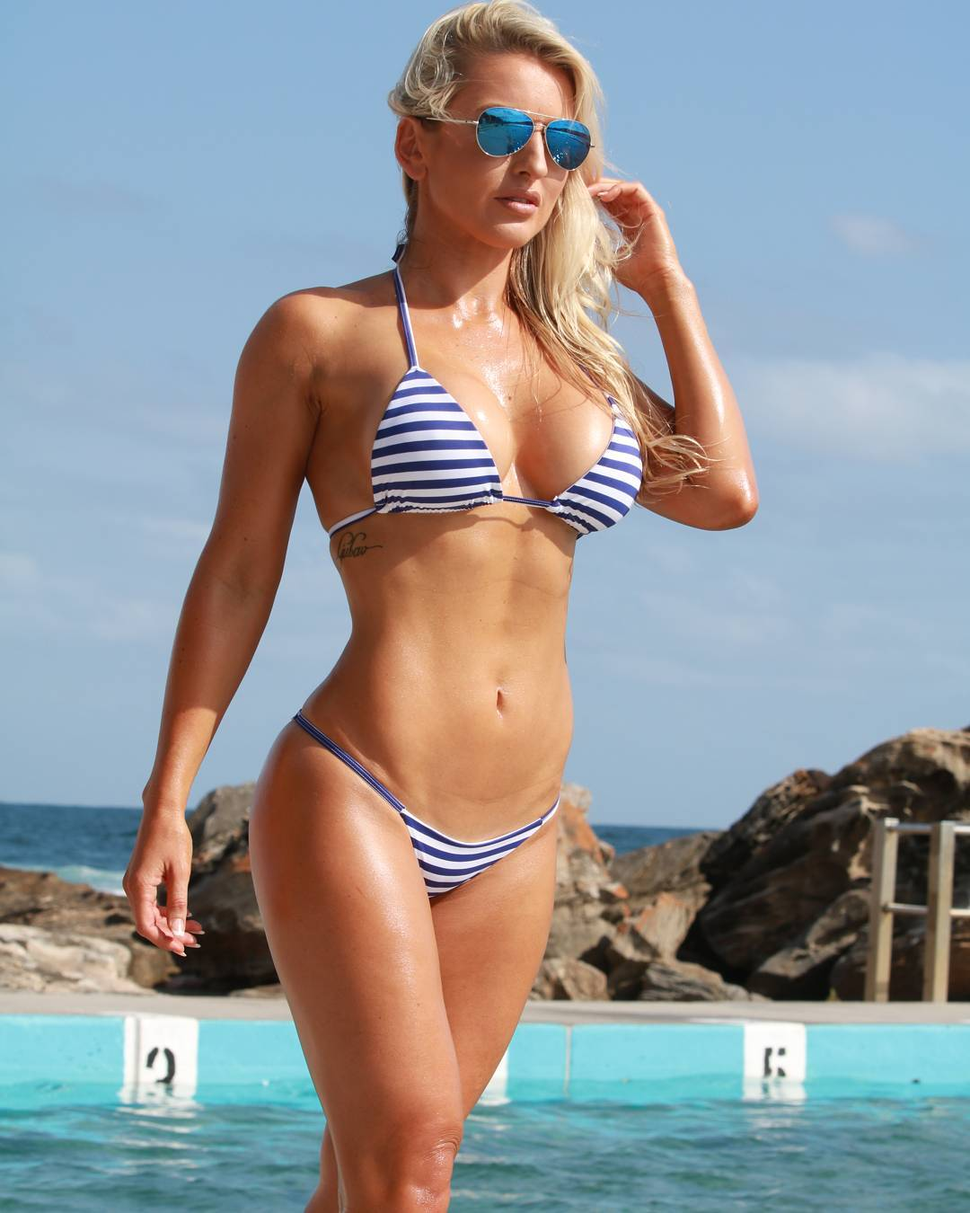 busty blonde fitness model Marijana Stojic in a sexy striped bikini