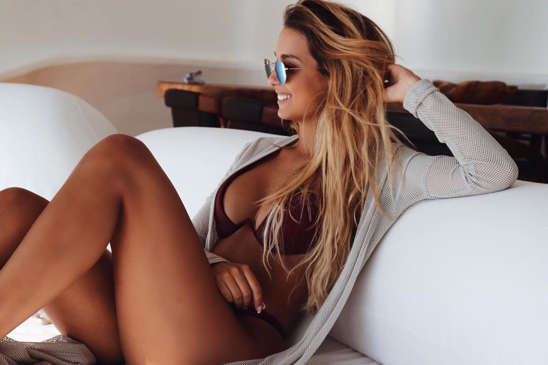 busty blonde Nana Mendes wearing sunglasses and lingerie