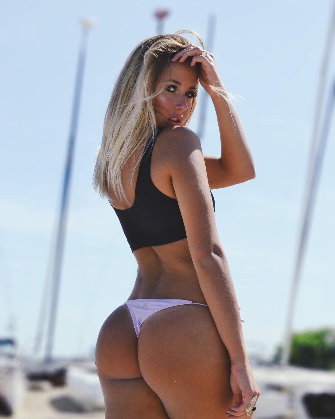 sexy young blonde model Kiki Passo showing off her perfect booty in a thong bikini